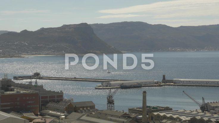 4k Yacht Sailing By Naval Dockyard Pier Ocean Mountains In Background - Stock Footage   by RyanJonesFilms