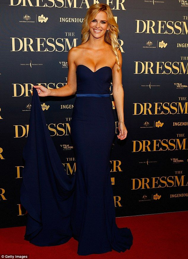 Glamorous: Former Big Brother star Jade Albany put on a busty display in a strapless dark blue gown