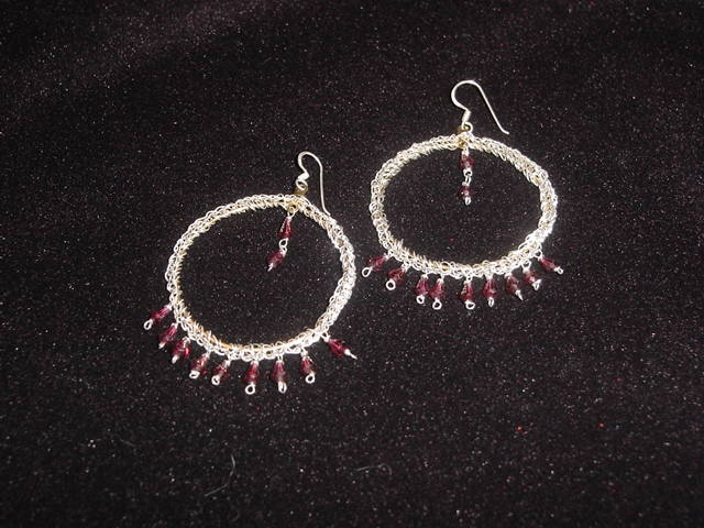 Earring with garnet beads