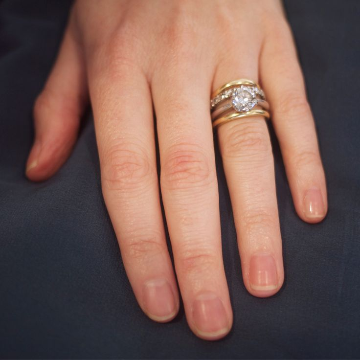 Mix Yellow & White Gold With Your Engagement Ring - If you have a classic brilliant-cut white goldengagement ring, you can absolutley mix in yellow gold rings and diamond eternity bands. The key is trying on different layers until you get it right.