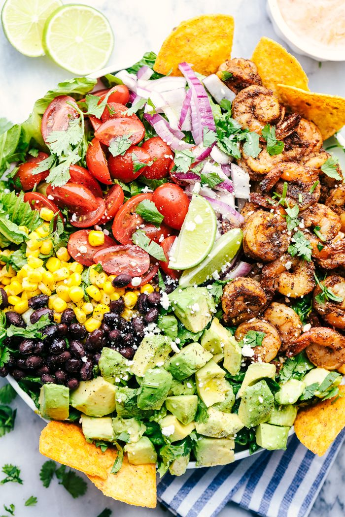 is full of fresh avocados, tomatoes, red onions, black beans and corn. The shrimp cook in a blend of delicious taco seasonings. This salad is unforgettable!