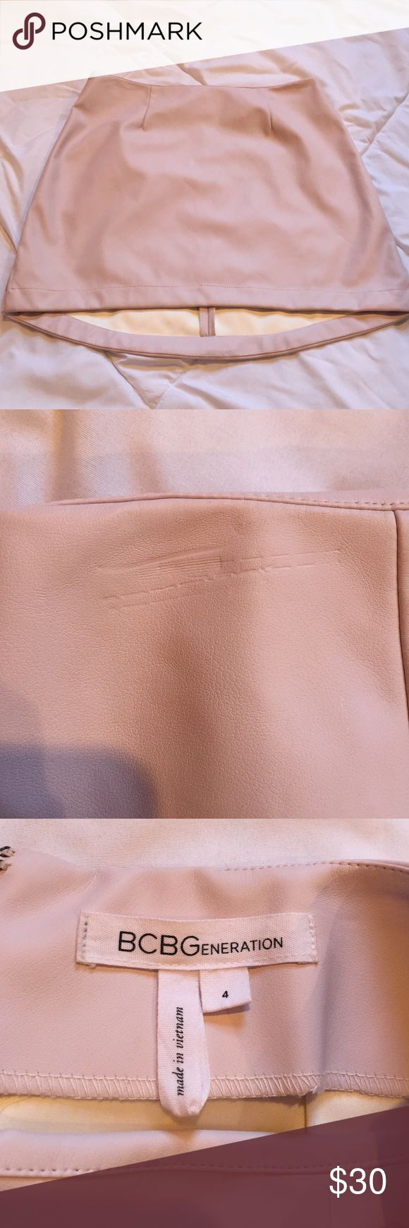 BCBG generation light pink faux leather skirt It is a size 4 regular waist pink leather mini skirt that is shorter in the front and longer in the back. I wore it once. It is in great condition besides the scratches at the top sides of the skirt (pictured above). BCBGeneration Skirts Mini