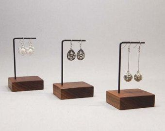 Earring Display  This unique earring display is perfect to display multiple pairs of earrings. It features offset tiers to allow earrings of various lengths.  The base is made from black walnut which has received several coats of natural oil to enhance the colour. The holder is made from steel which has been welded and then finished in matte black paint. The whole display is then finished with a clear coat for added protection and durability.  Not what youre looking for? We make all of our…
