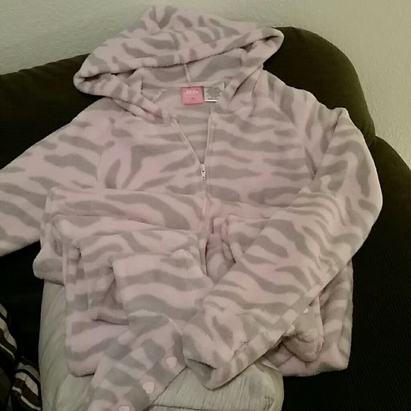 Jenni Adult Footie Pajamas Adult sized pink and grey zebra striped footie pajamas. Super comf!! No-skid feet. And THUMB HOLES! Only worn once. This is better than those open back snuggle things you see on tv. You have free movement and no matter what, especially in the freezing parts of the Country, your whole body stays warm! There's even a hood. You'll never want to take it off. Very gently loved. Jenni Intimates & Sleepwear Pajamas