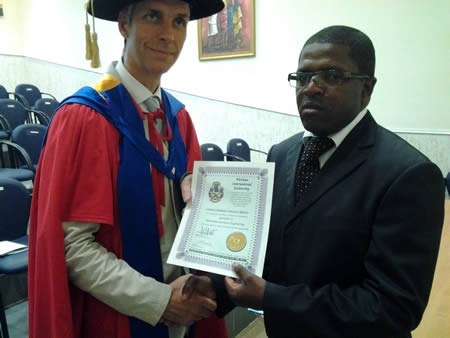 Cardoso Armando Francisco Narciso receives his diploma from Prof. William Martin, BIU CEO.