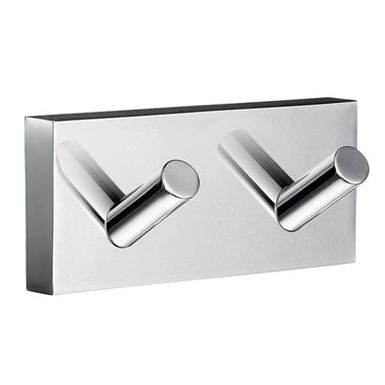 House - Double Towel Hook in Polished Chrome. Concealed fastening. Combining an angular mounting plate contrasting to the soft curves of each functional part. The core material is solid brass, finished in brushed or polished chrome.