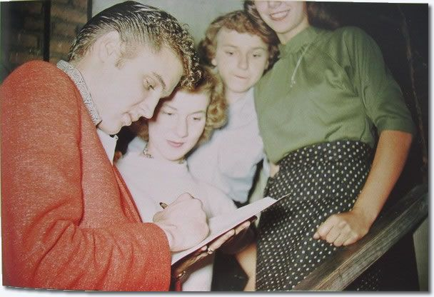 Elvis signs autographs for some female admirers in Cleveland, October 19, 1955.