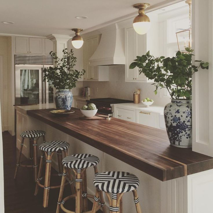 Pretty wood counter with fun stools