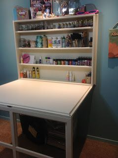 Drop down desk great for a small craft room-perhaps this could be the cutting table and paint supplies.
