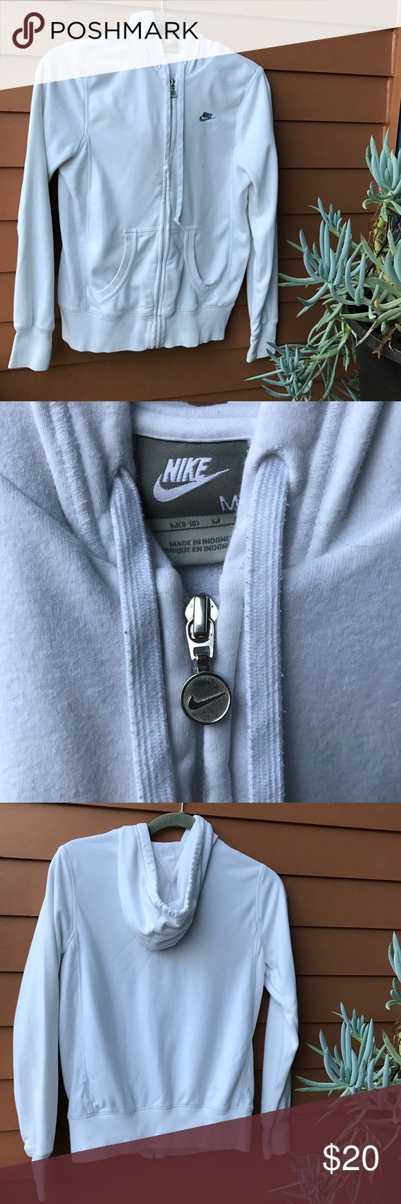 Nike white zip up hoodie sweatshirt medium Nike white zip up hoodie sweatshirt medium. Worn and washed once. A couple small and very un-noticeable stains on the back, photoed in last pictures for reference. Otherwise In good condition. Nike Tops Sweatshirts & Hoodies