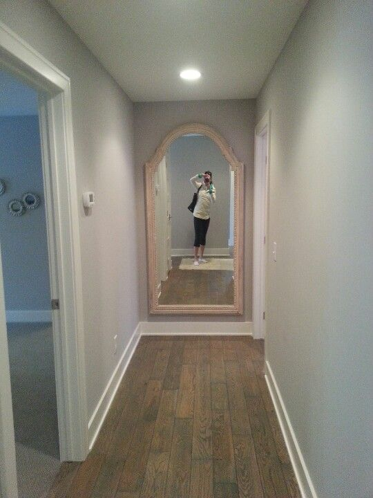 Love the big mirror at the end of the hallway--really extends the look of the hallway and brightens things up