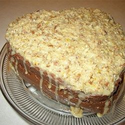 Coconut Pecan Frosting. Original recipe makes 1 cake's filling and frosting Change Servings  1 (14 ounce) can sweetened condensed milk   3 egg yolks   1/2 cup butter   1 1/3 cups flaked coconut   1 cup chopped pecans   1 teaspoon vanilla extract  In a heavy 2 quart saucepan over medium heat, cook the condensed milk, egg yolks, and butter 10 minutes, stirring constantly, until bubbly. Remove from heat, and stir in the coconut, pecans, and vanilla. 2. cool 15 minutes before spreading on cake.