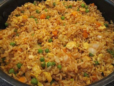 FRIED RICE 3 cups cooked white rice,  3 tbs sesame oil, 1 cup frozen peas and carrots (thawed), 1 small onion, chopped,  1tsp minced garlic, 2 eggs, slightly beaten,  1/4 cup soy sauce. Heat oil in a large skillet or wok on high. Add peas carrots, onion and garlic. Stir fry til tender. Push mixture to side. Pour eggs on the other side and stir fry until scrambled on low. Add the rice and soy sauce and blend all together well. Stir fry until thoroughly heated. Try adding some green onion.