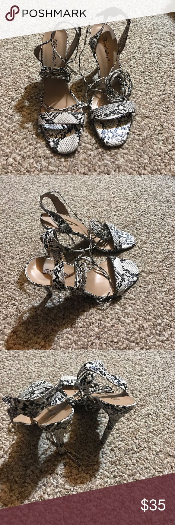 Black and white snake skin strappy heels. These are brand new strappy heels that were unfortunately were too small for me. These are cute for the summer and can be worn to multiple events. Shoes Heels