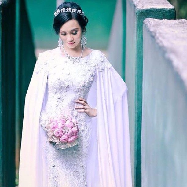 Ramona in white songket from Lumiere Wedding