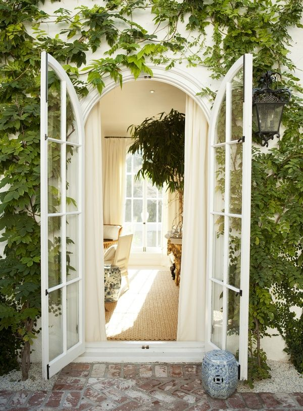 Arched French doors; Mark D Sikes