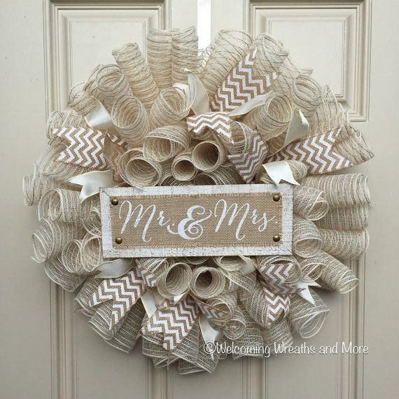 This beautiful and romantic burlap mesh wreath would be the perfect addition for a wedding, bridal shower, or the newlyweds front door. This wreath measures 24 in diameter and is constructed out of a soft beige burlap deco mesh. Coordinating wired ribbon in chevron burlap and beige surround the outside of the wreath. The wood and burlap sign reads, Mr. and Mrs. Ready to ship with free shipping! Check out our other wreaths here: http://www.welcomingwreathsmore.etsy.com