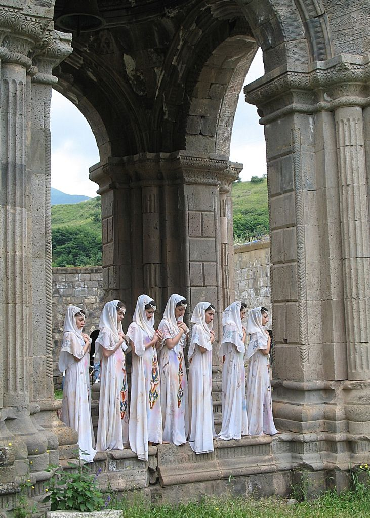 Armenian girls in traditional dress prepare for religious ceremony at the Tatev Monastery in Armenia