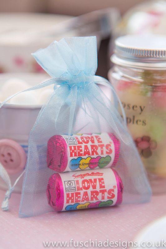 Voile bag favours with love heart sweets inside. www.fuschiadesigns.co.uk
