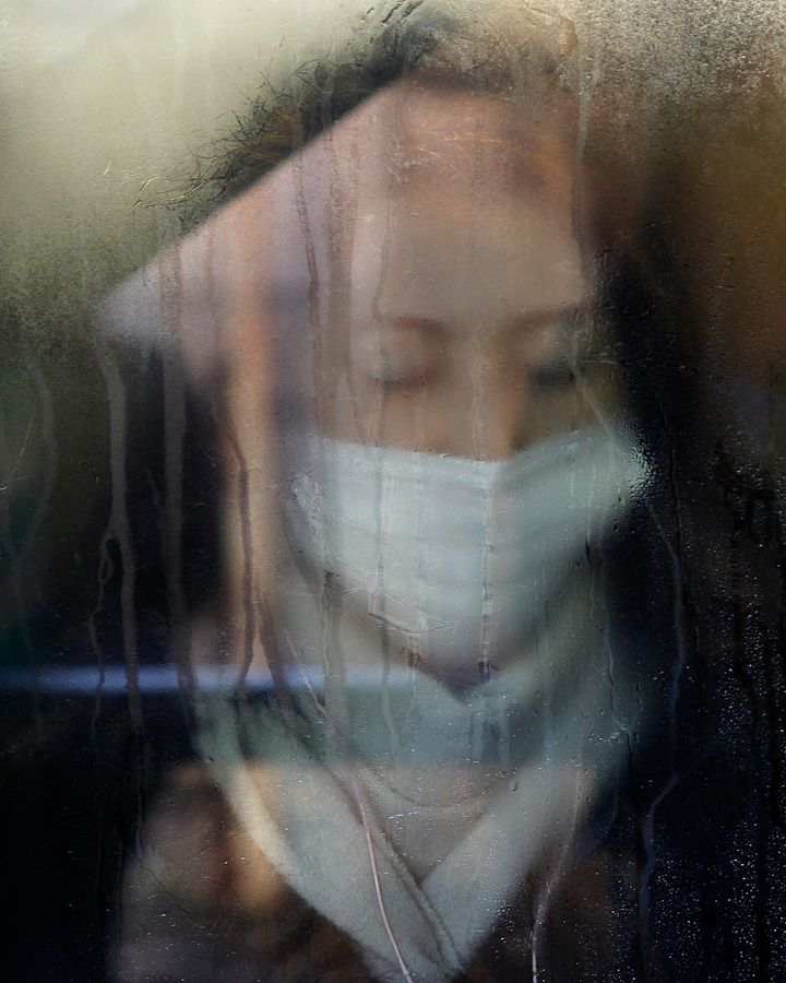 Michael Wolf photographing commuters in Tokyo. Amazing dream like images