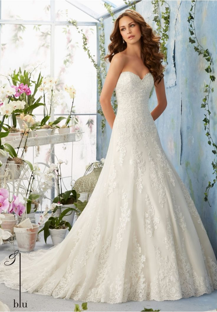 "Wedding Gowns By Blu featuring Embroidered Lace Appliques Decorate the Net Gown with Scalloped Hemline Over Soft Satin Available in Three Lengths: 55"", 58"", 61"". Colors available: White, Ivory, Ivory/Coco."