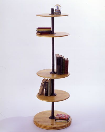 Shelves are mounted on threaded pipe - to adjust, you simply spin the shelf, allowing you to change heights without emptying the shelf! Genius...