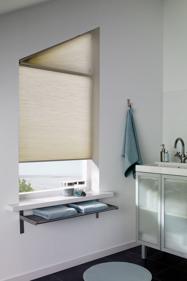 Natural Duette Bathroom Blind. Neutral home decor ideas. Window dressing for the bathroom. Energy saving blinds. Contemporary natural colour inspiration for the home. Modern window dressing. Unusual shaped windows.