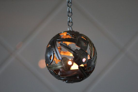 Mini key ball tea light Key sphere Metal sculpture by Moerkey $50.00 So cool. See also larger sizes of decorative key balls.