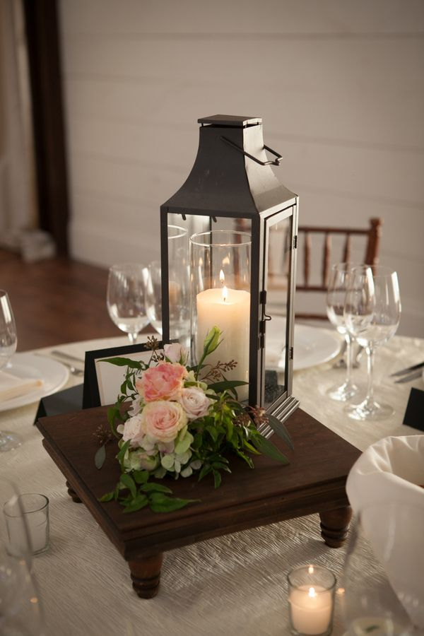 """Another idea is to put it in a mirror stand or """"plate"""" and add a floral centerpiece next to it. Then put the centerpieces on the table next day."""