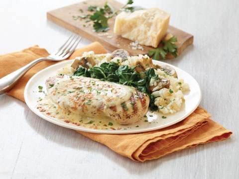 Creamy Parmesan Chicken from Applebee's served with steamed spinach and mushroom rice pilaf. Yum!