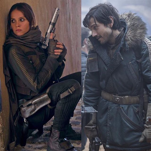Another view of Jyn's cool rebel outfit - the brown jacket, vest, scarf, the Han Solo gun belt, boots, and that silver blaster. A good look at Cassian's blue rebel parka.