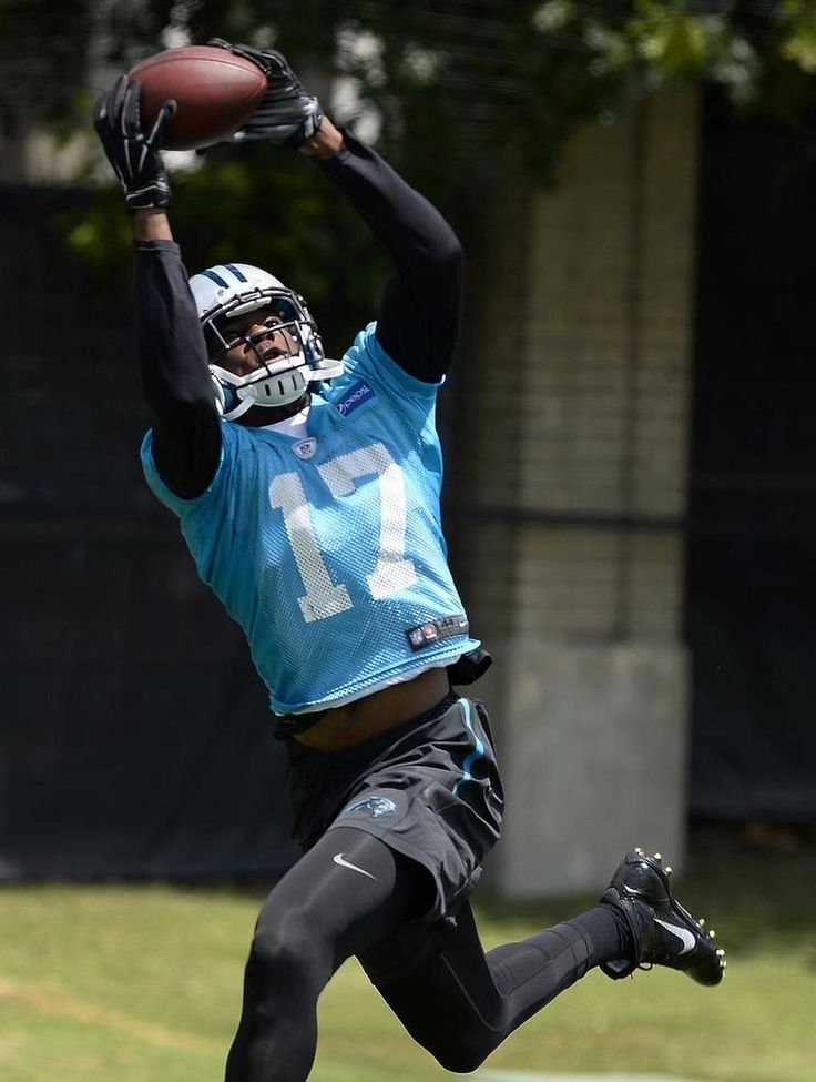 Carolina Panthers wide receiver Devin Funchess reaches up to catch a pass during practice on Thursday, June 11, 2015.