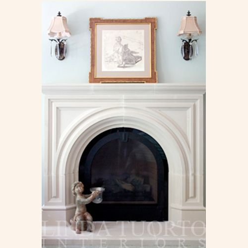 Anchor your room with our Rothton cast stone fireplace. A rounded arch & an ornate style fuses old & new into a modern or traditional living space.