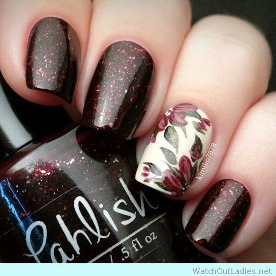 Beautiful glitter wine nail manicure with floral accent