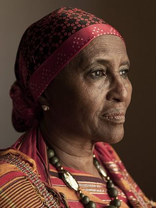 "Meet Hawa Abdi. A woman who has never raised her fist in anger against another human being, but also one who could perform three C-sections on dirt-poor women, wash her hands, then go straight outside, stare down an army of gun-toting hardcore fanatical Somali militiamen, and with four words send them running for their lives on a light-speed rainbow of shame and self-loathing without even blinking. A woman once appropriately described once as ""one part Mother Teresa, one part Rambo."""