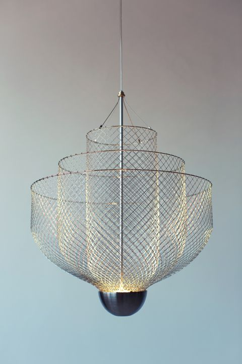 Meshmatics Chandelier by Atelier Rick Tichelaar. An integrated LED shines upward to illuminate the three layers of formed chicken wire. This way the mesh works as a reflector that spreads the light in the room and casts an elaborate web of shadows on the ceiling.