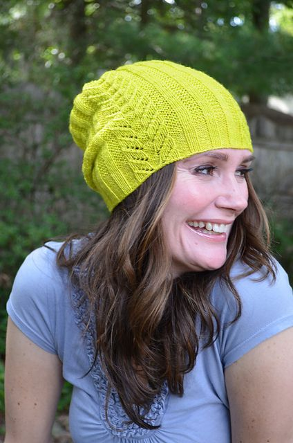 Paravel is a sweet little hat worked in fingering weight yarn. Panels of easy broken rib are separated by columns of Totem Pole lace, a traditional stitch pattern. The crown is shaped in graceful quadrants that meet in a tidy little quatrefoil. The pattern includes both a beanie and slouch version. The beanie is a trim little hat and sits nicely like an acorn's cap. The slouchier version has deeper ribbing at the edge and sits at a more relaxed angle.