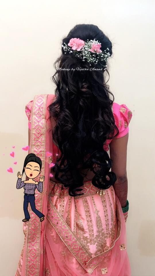 Gorgeous bridal reception hairstyle by Vejetha for Swank. Bridal updo. Curls. Hair accessory. Bridal flowers. Indian bride. Bridal pink lehenga.
