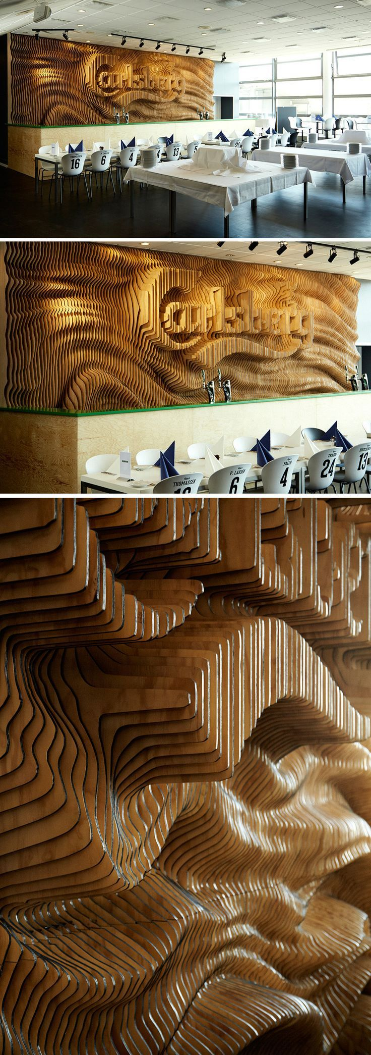 Creative agency Wonderland, have designed an organically shaped wooden wall, displaying the Carlsberg logo, for the bar at the Hall of Carlsberg in Copenhagen.