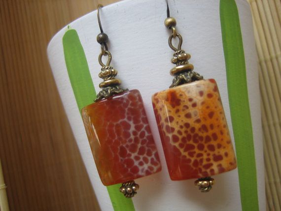 Antiqued brass filigree bead caps and small brass beads set off these uniquely marked real fire agate stones. Nickel free brass fish hook ear wires make these earrings easy to wear every day, and they come with small stoppers to keep them firmly in place.  $27.00