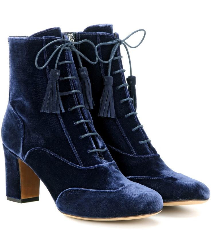 Tabitha Simmons - Afton velvet ankle boots - Tabitha Simmons' Afton ankle boots are crafted in Italy from plush velvet in demure navy. The lace-up front and chunky heel keep the impression traditional yet feminine for a look that pairs equally well with tailored trousers as it does with printed skirts. Tasselled laces add a playful finish. seen @ www.mytheresa.com