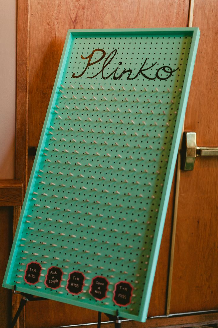 Wedding kissing game plinko. Photo by M&Him