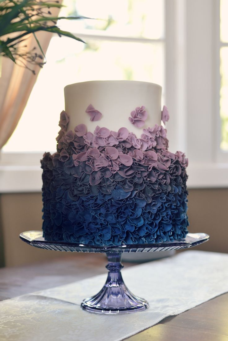 Modern elegant wedding cake with ruffles ombre from royal blue to purple. Country Cake Shop
