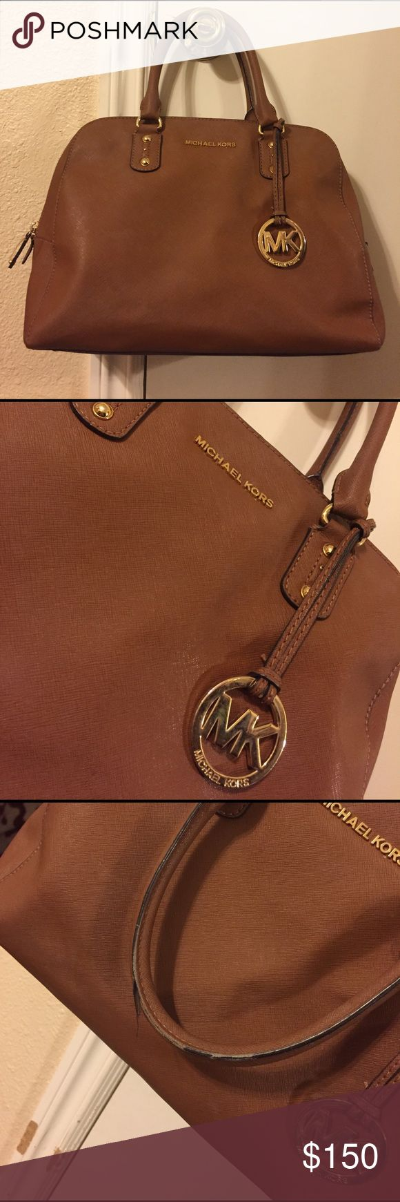 Michael Kors bag Authentic. Used. Signs of wear can be seen on straps and inside bag are marks. Still a lot of life in this bag. Comes with cross body strap that has never been used. Saffiano leather Michael Kors Bags