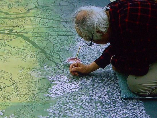 Japanese painter Junsaku Koizumi (1924-2012) at work.