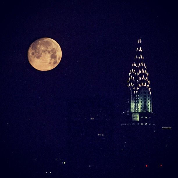 """Holy Supermoon, Batman! Did you catch the """"biggest"""" moon of the year last night? If not, #mikemou has you covered with this beautiful shot of it hanging over #NYC. #Supermoon #IGoftheDay #brooklynbowl #brooklyn #concerts #NYC #livemusic #bowlstagram #todaysbestIG"""