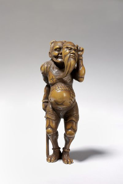 Japanese carved wood netsuke, Victoria and Albert Museum storage collection- an Oni with a mask of Shojo