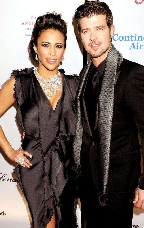 robinthicke-Robin Thicke and wife Paula Patton. They have a son together. Not sure if they are still together.