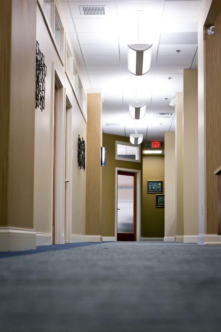 commercial hallway, great light fixtures  #commercial #design #interiordesign #hhi #henriettaheisler #buissness #hallway #carpet #lighting #flourescents #warm #tan #walldecor #contemporary