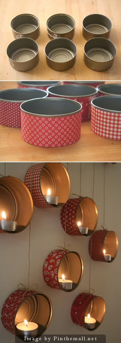 Recycled cat food/tuna cans turned into candle holders! This would be great outside for a party! Attach to a fence, your house or out building- along with some strings of mini lights, some vines and instant charm...